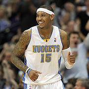 DENVER, CO - APRIL 17 : Carmelo Anthony #15 of the Denver Nuggets celebrates after sinking a shot against the Utah Jazz during the second half of Game One of the Western Conference Quarterfinals of the 2010 NBA Playoffs at the Pepsi Center on April 17, 2010 in Denver, Colorado. The Nuggets won the game 126-113 to take a 1-0 lead in the series. (Photo by Marc Piscotty/ © 2010)