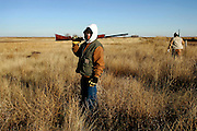 Sean Little stops for a moment while looking for pheasants at the Annual Pleasant Hill Fire Department Pheasant Hunt on Thursday, December 7, 2006.