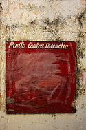 Weathered wall and sign in Playas del Este, Havana, Cuba.