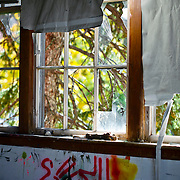 SHOT 10/13/09 12:28:03 PM - Broken windows in an abandoned factory in Buffalo, NY. Buffalo, N.Y. is the second most populous city in the state of New York and is located in Western New York on the eastern shores of Lake Erie and at the head of the Niagara River. By 1900, Buffalo was the 8th largest city in the country, and went on to become a major railroad hub, the largest grain-milling center in the country and the home of the largest steel-making operation in the world. The latter part of the 20th Century saw a reversal of fortunes: by the year 1990 the city had fallen back below its 1900 population levels. (Photo by Marc Piscotty / © 2009)