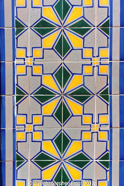 An example of an Iberian Moorish style of design. Slightly grungy and chipped edging to tile pattern suggesting antiquity.