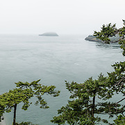 See North Beach and Macs Cove on Whidbey Island in Deception Pass State Park, and look across the strait to Fidalgo Island (right), in Washington, USA. This is the most-visited State Park in Washington. The strait of Deception Pass connects Skagit Bay (part of Puget Sound) with the Strait of Juan de Fuca, which are all part of the Salish Sea. This panorama was stitched from 3 overlapping photos.
