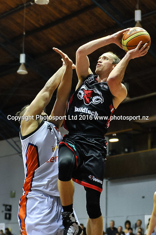 Justin Graham of the Rams drives to the basket over James Paringatai of the Southland Sharks  during the NBL Basketball Match, Canterbury Rams V Southland Sharks, Cowles Stadium, Christchurch, New Zealand. 25th March 2016. Copyright Photo: John Davidson / www.photosport.nz