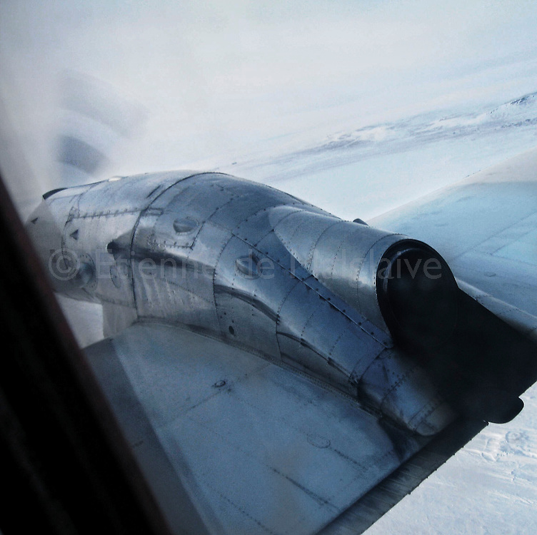 Flying on a old First Air HS 748 over Nunavut, 2006.