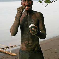 Egg collector from Matupit Island, Rabaul, East New Britain, Papua New Guinea