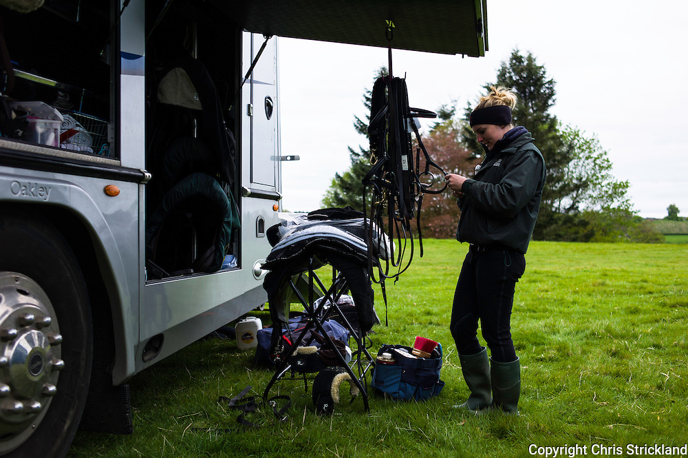 Floors Castle, Kelso, Roxburghshire, UK. 14th May 2015.  A groom for the Hope family based in Oxfordshire prepares tack prior to competiton.