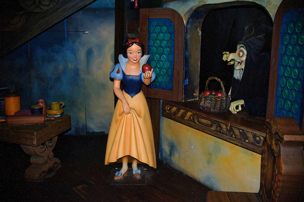 """photo by Matt Roth.Tuesday, May 1, 2012..The Evil Queen's alter ego the """"witch"""" or """"hag"""" gives a poisoned apple to Snow White on the ride. After forty-one-years, Disney World is closing the Snow White's Scary Adventure ride June 1st of this year."""