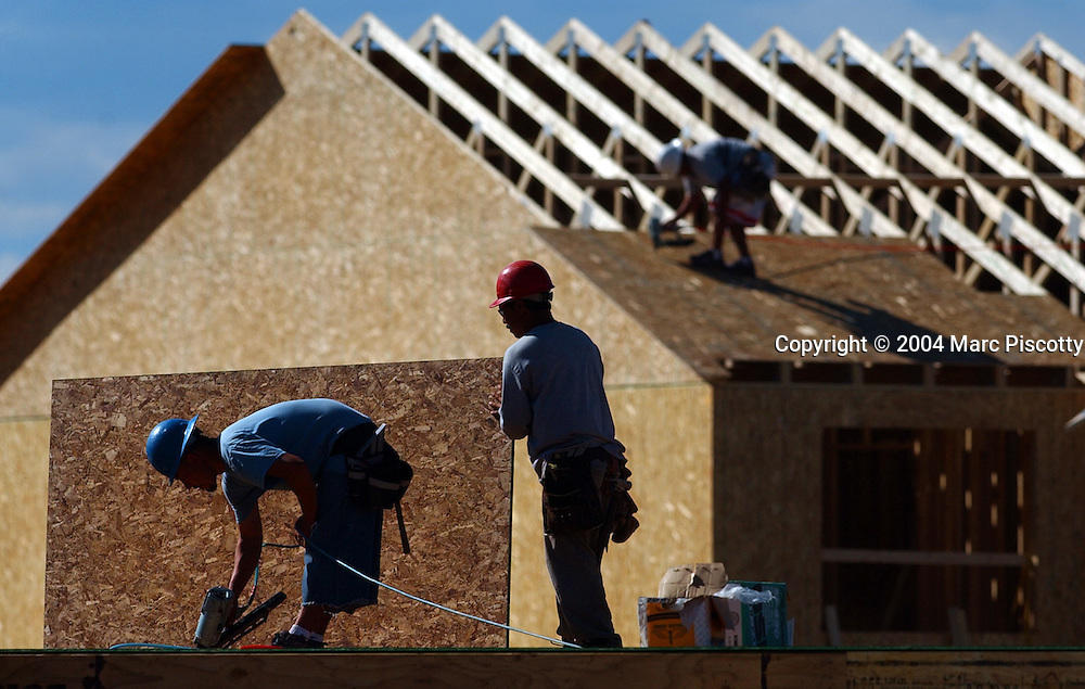 (CASTLE ROCK, Co., SHOT 9/17/2004).Construction workers Saul Galicia (left, with blue helmet) and Noe Carrillo (right, with red helmet), both of Denver, frame homes in the Feathergrass Neighborhood of The Meadows housing community in Castle Rock Friday. The 4,000 plus acre development is back under development after being purchased by the Castle Rock Development Company from the previous developer. The community features homes and townhouses in a variety of price points and a community center called The Grange at The Meadows. Castle Rock is located about 35 miles south of Denver and 40 miles north of Colorado Springs on the Interstate 25 corridor just east of the front range of the Rocky Mountains. The town is the center of the burgeoning urbanization of the county. As of 2005, the city is estimated to have a total population of 35,745.[4] Castle Rock is now the 19th most populous municipality in the State of Colorado..(Photo by MARC PISCOTTY / © 2004)