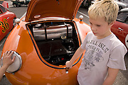 Image of a boy at the Rennsport Reunion III at Daytona International Speedway, Daytona, Florida, American Southeast, Porsche 356, not model released