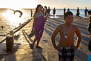 The late afternoon scene on Sugar Dock, on the beach in Saipan. The beach and dock is a popular local swimming and party spot on the island.