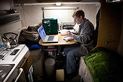 Clare Moxley eats dinner in the RV she lives in while working a seasonal job at an Amazon warehouse in Fernley, Nevada, December 13, 2011. CREDIT: Max Whittaker/Prime for The Wall Street Journal.AMAZONTOWN