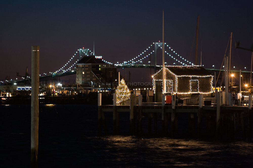 Holiday lights at the end of Bannister's Wharf with the Pell Bridge in the background