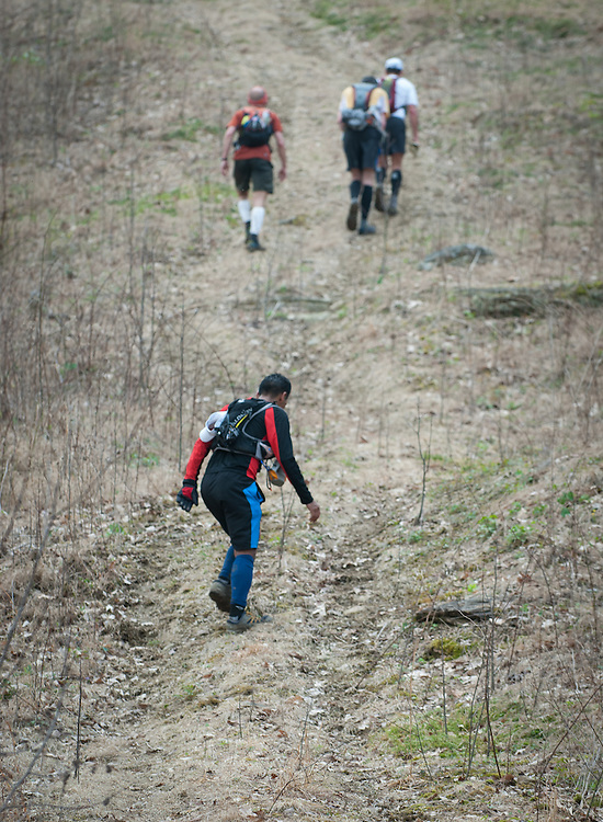 Iso Yucra, foreground, climbs the final pitch of the the Testicle Spectacle during the Barkley Marathons.