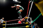Lucha Libre AAA wrestler Joe Lider jumps onto Crazyboy at a match in Sacramento, CA March 28, 2009.