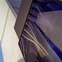 The World Trade Center is shown in 3 iterations; a poster, a reflection, and the actual North Tower.