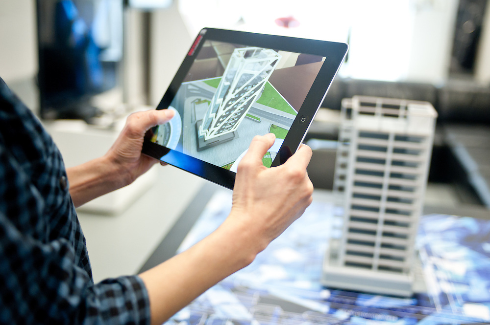 Augmented reality application to overlay CAD models onto a 3D printed building structure for Drees and Somer. Showing internal structures, floor plates interactive slicing the building by floor, landscaping, animated cars and people around the model. Model created direct form CAD data using a Initions 3Dsystems Projet 660 colour 3D printer. Optimised model to run in realtime on an iPad4.