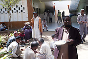 Patients taking food at the Edhi Foundation Home for Men and Boys on the outskirts of Karachi. Those not deemed a risk to themselves and others may roam outside of the wards. The facility currently holds some 1132 men and 300 boys with a staff of 40 including one doctor. Te shelter acts as a 'catch all' safety net giving those who are mentally or physically disabled as well as those who have no where else to go a refuge in a the absence of any state help. most at the facility have been abandoned by their families, and have nothing in the way of personal possessions, the clothes they wear are mostly donated. there are no education/voactional training facilities on site for adults and medical support is basic at best...The youngest, a mentally disable boy is 8 years old whilst the oldest, an 84 years old homeless person. According to Dr Kamal the resident doctor, there are about 80-100 admissions in a week to the senior citizens hall while between approximately 16 people die every month, mostly because of old age. ..The mentally disabled patients receive occasional consultant visits and whilst they are administered prescribed medicines to keep them manageable, no measures are taken to improve their condition or help them become independent in their daily routine...The Edhi facility is able to meet merely their survival needs of the men and boys. Some patients are visited by relatives, very few leave the facility unless there is a guarantee of care from a relative. meals are basic consisting of traditional biryani type rice dish and there is little in the way of running water and electricity. At the time of visit water bowsers were being delivered to the the facility to cater for water consumption. patients sleep some 30 to a room some as may as 80 depending on the mental and physical abilities of the patients....In a country of some 160 million people, affordable medicines and diagnostic tests are beyond the reach of most people in Pakistan. The country suffers from s