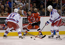 Feb 20, 2007; East Rutherford, NJ, USA; New Jersey Devils forward Jaime Langenbrunner (15) slides a pass by New York Rangers defenseman Fedor Tyutin (51) during the first period at Continental Airlines Arena in East Rutherford, NJ.