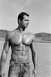 shirtless hunk walking in the desert
