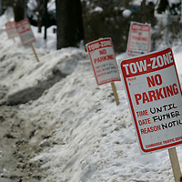 Cambridge, MA -  Temporary 'No Parking' signs stuck in the snow banks, line one side of Walden Street on January 28, 2010.  Photo by Matthew Healey