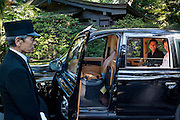 Wedding couple in their limo, at the Meiji Shrine in Shibuya, Tokyo. It is the Shinto shrine dedicated to the deified spirits of Emperor Meiji and his wife, Empress Shōken. It's a popular wedding destination.