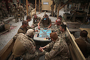 Soldiers playing a table game waiting for new orders inside an District Headquarters near Nawabad, whcih is located inside the District Headquarters of the afghan Police. In late October 2011 Kunduz based 3.Task Force started a several days operation in and around Nawabad (District Chahar Darah), west of Kunduz, northern Afghanistan. During the Operation Orpheus about 100 german infantery soldiers rolled out for patrols through the town and surrounding areas, which were expected as a retreat zone of insurgents.