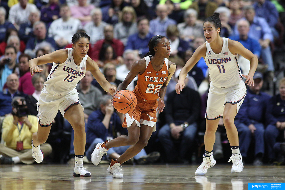 UNCASVILLE, CONNECTICUT- DECEMBER 4: Tasia Foman #22 of the Texas Longhorns in action while defended by Gabby Williams #15 of the Connecticut Huskies and Kia Nurse #11 of the Connecticut Huskies during the UConn Huskies Vs Texas Longhorns, NCAA Women's Basketball game in the Jimmy V Classic on December 4th, 2016 at the Mohegan Sun Arena, Uncasville, Connecticut. (Photo by Tim Clayton/Corbis via Getty Images)