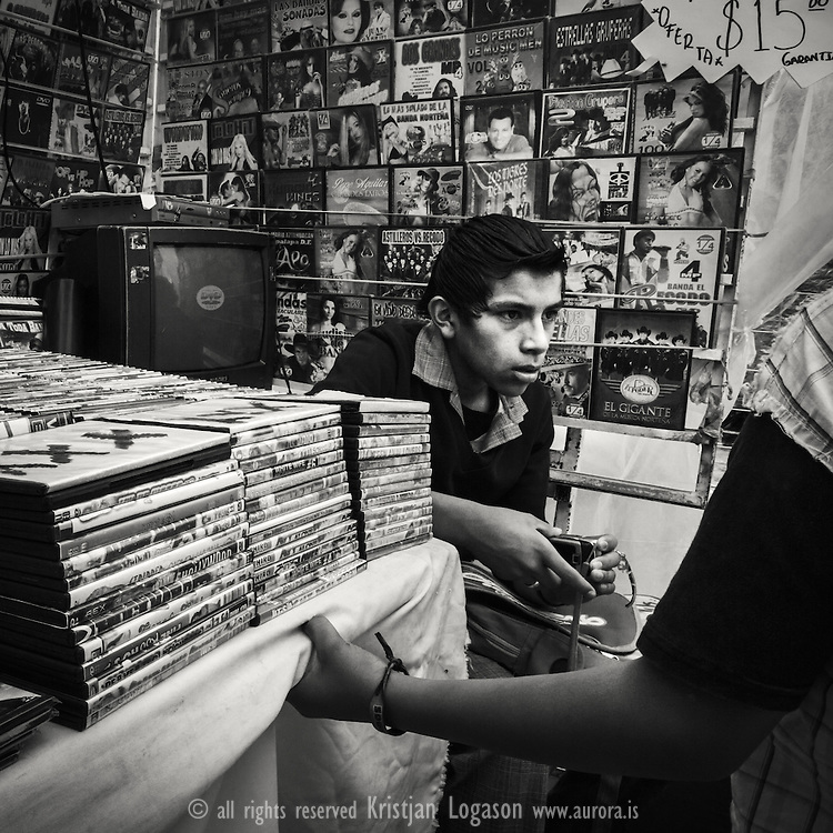 Young boy in Guanajuato mexico selling illigal pirate copies of movies and tv programs