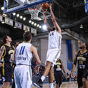 Reno Bighorns 7 foot 5 Center Sim Bhullar (44) dunks the ball as in the second half of a NBA D-league regular season basketball game between the Delaware 87ers and the Reno Bighorns (Sacramento Kings), Tuesday, Feb. 10, 2015 at The Bob Carpenter Sports Convocation Center in Newark, DEL