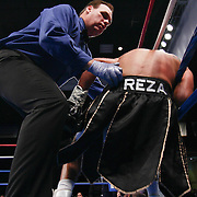 Referee helps up Welterweight boxing pro Francisco Reza  during champs at the chase against Welterweight boxing pro Cecil Mccalla of Baltimore, MD who knocked out Reza in round one Friday, Nov 21, 2014 at The Case Center on The River Front in Wilmington, Del.