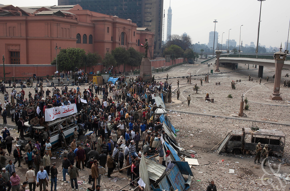 Anti-Hosni Mubarak protesters take up positions behind makeshift barricades during clashes with nearby Mubarak supporters near Tahrir square area February 03, 2011  in Cairo, Egypt. Protesters from both sides clashed throughout the day, throwing rocks and fighting at close range. . .Photo by Scott Nelson