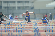 Oxford High's Toler Presley hurdles during the Oxford Eagle Invitational track meet at Oxford High School in Oxford, Miss. on Saturday, March 9, 2013.
