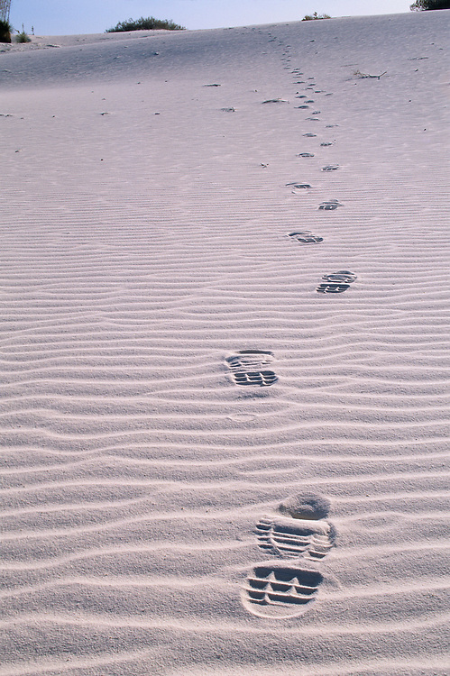 USA, New Mexico, White Sands National Monument, Hiker's boot prints left in gypsum sand dunes in Chihuahua Desert at dawn