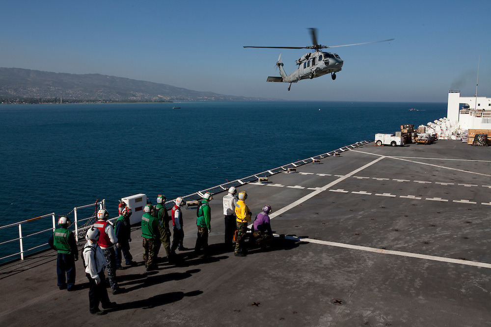 An MH-60S helicopter lands on board the USNS Comfort, a U.S. Naval hospital ship, with Haitian earthquake victims needing medical treatment on January 21, 2010 in Port-au-Prince, Haiti. The Comfort deployed from Baltimore with 550 medical personnel on board to treat victims of Haiti's recent earthquake, and arrived on January 20.