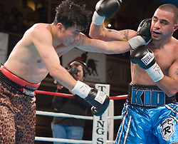 March 9, 2006 - New York, NY - Gary Stark Jr. (r) and Debind Thapa (l) trade punches during their featherweight bout at the Manhattan Center in New York City.  Stark Jr. won the bout via 5th round TKO.