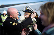 Petty Officer Michael Beaumont from Hull hugs his 21 month old daughter Eloise, after the Type 23 frigate HMS Richmond returned to Portsmouth Royal Navy Base following a seven-month deployment to the South Atlantic. Picture date: Friday 21st February, 2014. Photo credit should read: Christopher Ison. Contact chrisison@mac.com 07544044177