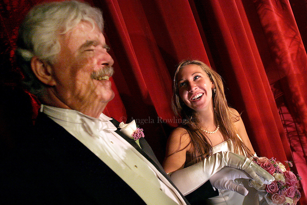 06/16/06 Boston, MA-- Amanda McGuire, 18, of Boston, laughs with her father Francis backstage before her presentation during the Boston Cotillion.  (061606cotillionar05, saved in adv news, Staff Photo by Angela Rowlings)