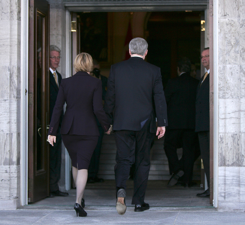 Prime Minister Stephen Harper and his wife Laureen arrive at Rideau Hall in Ottawa Saturday March 25, 2011 to ask Governor General David Johnston to dissolve Parliament so there can be an election. The Conservative government was defeated, found in contempt of Parliament in anon-confidence vote Friday. Canadians will be heading to the polls in May.<br /> AFP/GEOFF ROBINS/STR