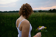 Melissa holds a batch of handpicked flowers in Eastlake, Ohio on July 1, 2006.