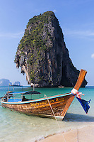 Railay Beach is found on a remote peninsula between Krabi Town and Ao Nang Beach and is accessible only by boat because of huge limestone cliffs that shut off road access. The magnificent cliffs attract rock climbers from around the world and is extra popular because of its pristine beaches. This famous beach is framed by limestone cliffs at both ends making it distinctive from all the other world-class beaches in Thailand.