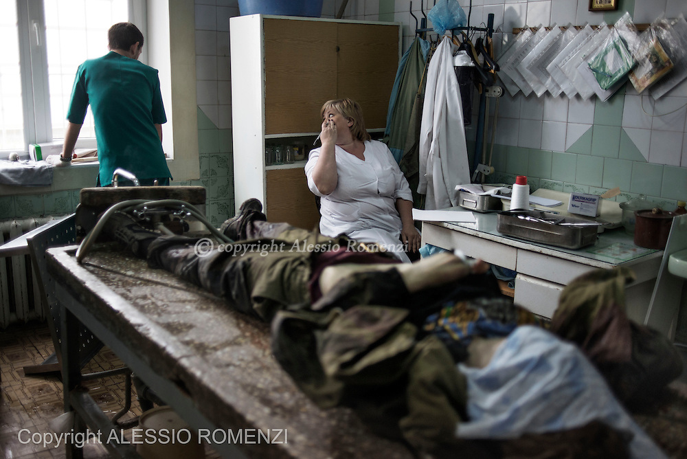 Ukraine, Donetsk: The body of pro-Russian gunman killed in clashes with Ukrainian government forces around the airport is seen inside a city morgue in Donetsk on May 27, 2014. ALESSIO ROMENZI