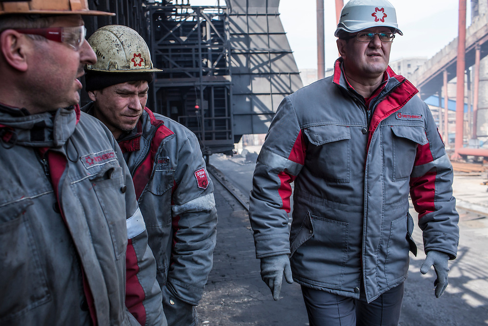 AVDIIVKA, UKRAINE - MARCH 18, 2015: Musa Magomedov, right, general manager of the Avdiivka Coke and Steel plant, with other plant workers in Avdiivka, Ukraine. CREDIT: Brendan Hoffman for The New York Times