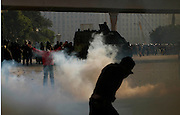 A Demonstrator suffering from tear gas inhalation during  clash with Egyptian police in Cairo, Egypt January 28,2011. (Photo by Heidi Levine/Sipa Press).