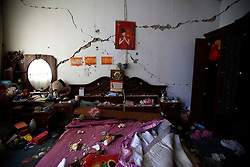 A view of the interior of a bedroom destroyed by the Lushan earthquake in Longmen Village of Lushan County, Sichuan Province, China, 22 April 2013. The Lushan Earthquake in Sichuan Province on 20 April 2013 resulted in 186 people dead, 21 missing, 11248 injured. About 1.72 million people were affected by the quake, while an initial estimate by the International Red Cross on Saturday put the number needing emergency shelter, water and food at 120,000. The China Earthquake Administration (CEA) recorded a magnitude 7.0 earthquake, while the US Geological Survey said it had measured 6.9.