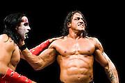 Lucha Libre AAA wrestlers Dark Scoria, left, and El Mesias, right, battle in Sacramento, CA March 28, 2009.