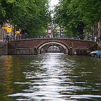 Europe, Netherlands, Amsterdam. Canal Bridge.