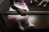 A girl performs during her ballet class at the 'Ballet Santa Teresa' academy in Rio de Janeiro August 15, 2012. 'Ballet Santa Teresa', a non-governmental organization (NGO) gives children who live in areas with social risk, some suffering domestic violence, free ballet classes and other activities as a part of socio-cultural integration project.  Photo by: Pilar Olivares
