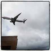 2012 May 4 - An American Airlines plane flies over Georgetown, Seattle, WA on approach to Boeing Field. By Richard Walker