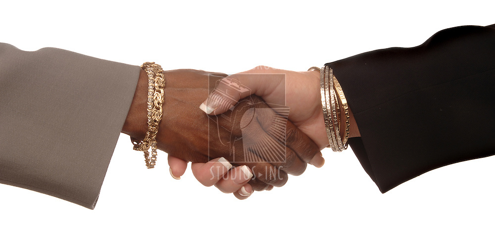 Two women shaking hands on a white background: one caucasian and one African American