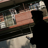 AUM SHINRIKYO /ALEPH CULT HEADQUARTERS. Policeman monitoring the acitivities of cult members outside buildings occupied by Aum Shinrikyo Supreme Truth Cult, now known as Aleph, in Tokyo, Japan.